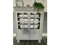 Newly refurbished vintage book display gin cabinet