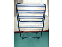 A folding, single, occassional bed.