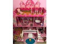 Princess dolls castle with furniture.