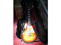 Gibson Les Paul Standard, sunburst 2004 model, with case. Working guitar in pretty good condition.