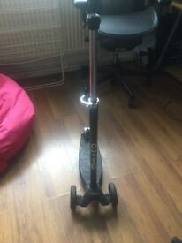 Black maxi scooter with joy stick