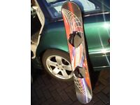 RED PATTERN SNOWBOARD IN GOOD CONDITION.