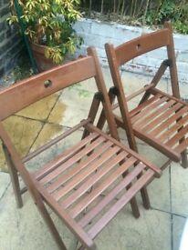 4 Ikea foldable wooden chairs - 2 dark brown and 2 medium brown