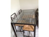 Ikea Granas glass dining table and chairs great condition.