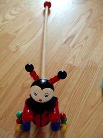 wooden walker trolley stick push along rattle clown wheels almost new