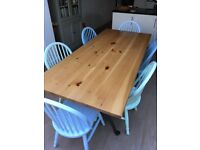 6ft 6in solid wood dining table and six painted chairs