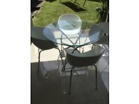 Dwell Glass Table with 4 white chairs