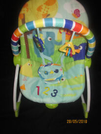 Bright Starts Vibrating Baby rocker and toddler chair with toy bar