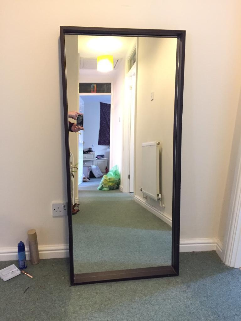 Brown leather surround mirrorin Sketty, SwanseaGumtree - large mirror (130cm x 60cm) in great condition. It has got a metal string to be mounted. Please pick up