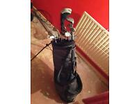 Set of golf clubs with golf bag