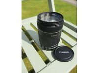 Canon EFS 18-135 I.S. lens with UV filter and caps in excellent condition.