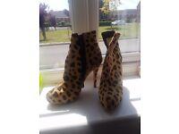 Louboutin horse hair boots heels