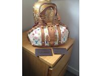 Authentic Louis Vuitton Theda handbag