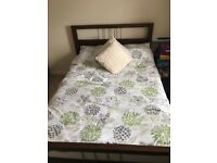 Double bed with mattress and memory foam topper