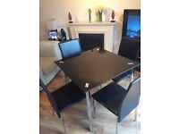 Black glass dining table & four chairs