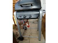 2 Burner Gas BBQ with full 13kg Gas bottle. BBQ used once only but missing grill rack.