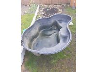 Fish pond and pump approx 7ft - 4ft
