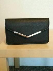 Black envelope clutch bag leather