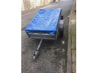 Camping trailer with spare wheel