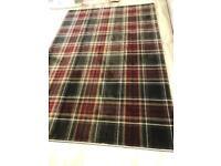 Red/grey check tartan rug
