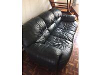 Leather sofa in very dark green
