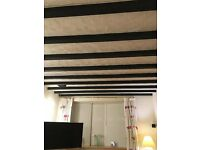 Beams for sale, black, previously used on a ceiling, now taken down.