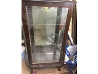 Dark wood and mirror back glass cabinet