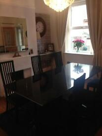 Housing Units large granite dining table with 6 chairs.