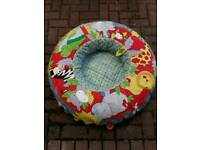 Baby sit up ring in good condition animals