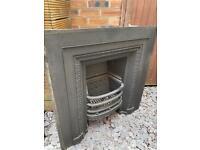 Cast iron fireplace with wood surround/mantel