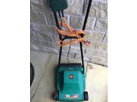 Black & Decker GR 120 Lawnmower. Very light with spare blades. Works perfectly.
