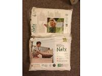 Two packets of unopened size 6 / toddler naty nappies.