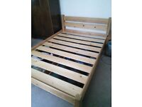 Wooden double bed with storage