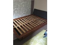 Double bed frame with double drawers and headboard