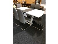 BRAND NEW MODERN TABLE AND SIX GREY LEATHER CHAIRS