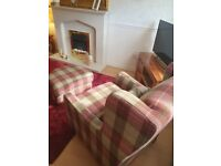 Sterling furniture tartan wingback armchairs, cushions and footstool.