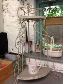 A pair of shabby chic corner shelves with grey limed finish.