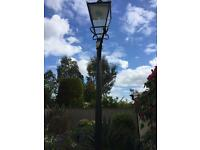 Vintage lamp post with lantern top