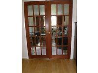 Internal glazed wooden double doors.