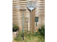 Garden tools: metal rake and shovel