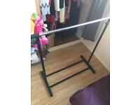 Clothes rail adjustable height