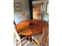 Skovby extending rosewood dinning table and 6 chairs