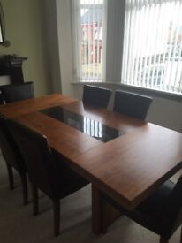 Solid wood table plus 6 leather chairs.