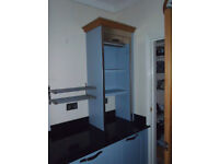 KITCHEN CUPBOARD WITH TAMBOUR CLOSURE