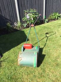 Qualcast electric lawn mower with roller