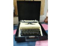 Vintage Remington Graduate typewriter in original carry case