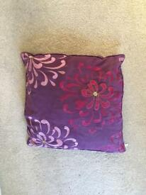 Purple & Pink floral patterned cushion.