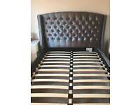 Grey velvet fabric king size bed.