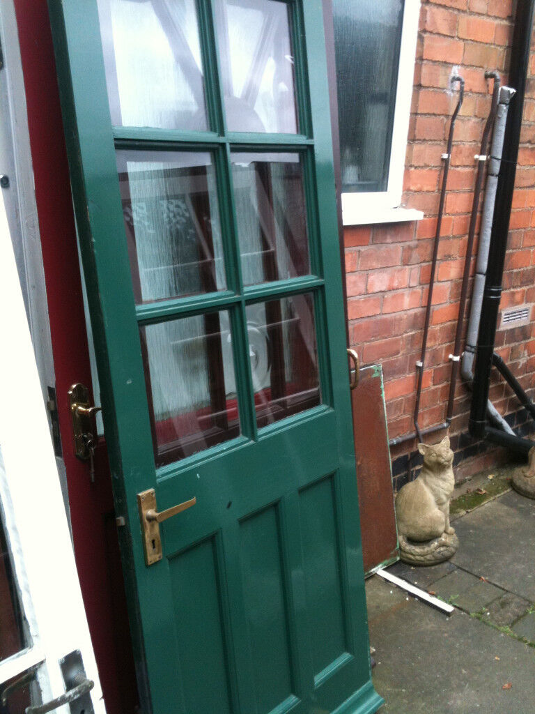 Exterior wooden door with clear glass squares