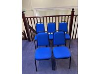 5 Bright blue office conference chairs.